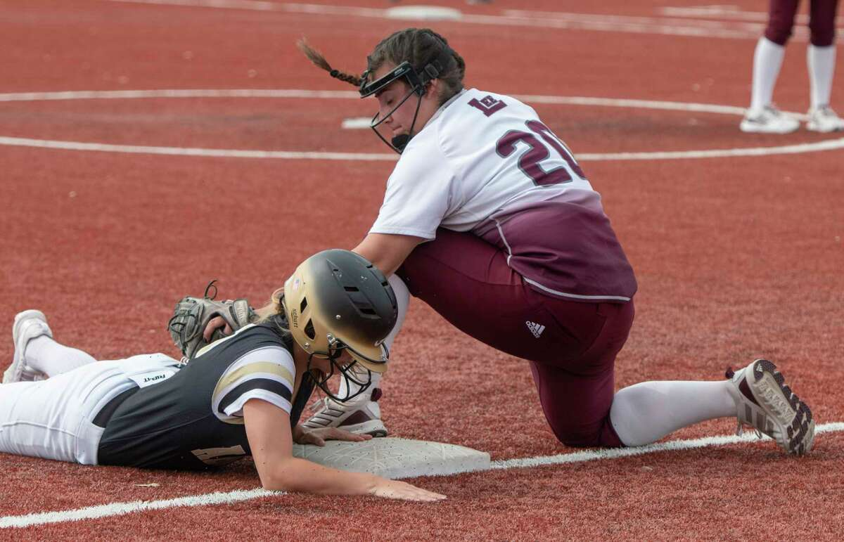Lee High's Chasity Trevino is too late to make the tag as Abilene High's Emma Mora safely steals third 03/12/21 at Gene Smith Field. Tim Fischer/Reporter-Telegram