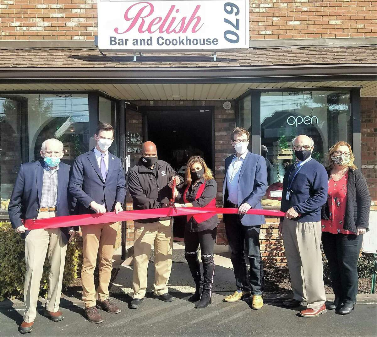 Relish670 in Middletown held a grand opening March 10. From left are Middlesex County Chamber of Commerce President Larry McHugh, Mayor Ben Florsheim, owners Harold Oliver and Debbie Licho, state Sen. Matthew Lesser, Economic Development Specialist Thomas Marano and chamber ambassador and director of fund development for the Middlesex YMCA, Lori Lodge.