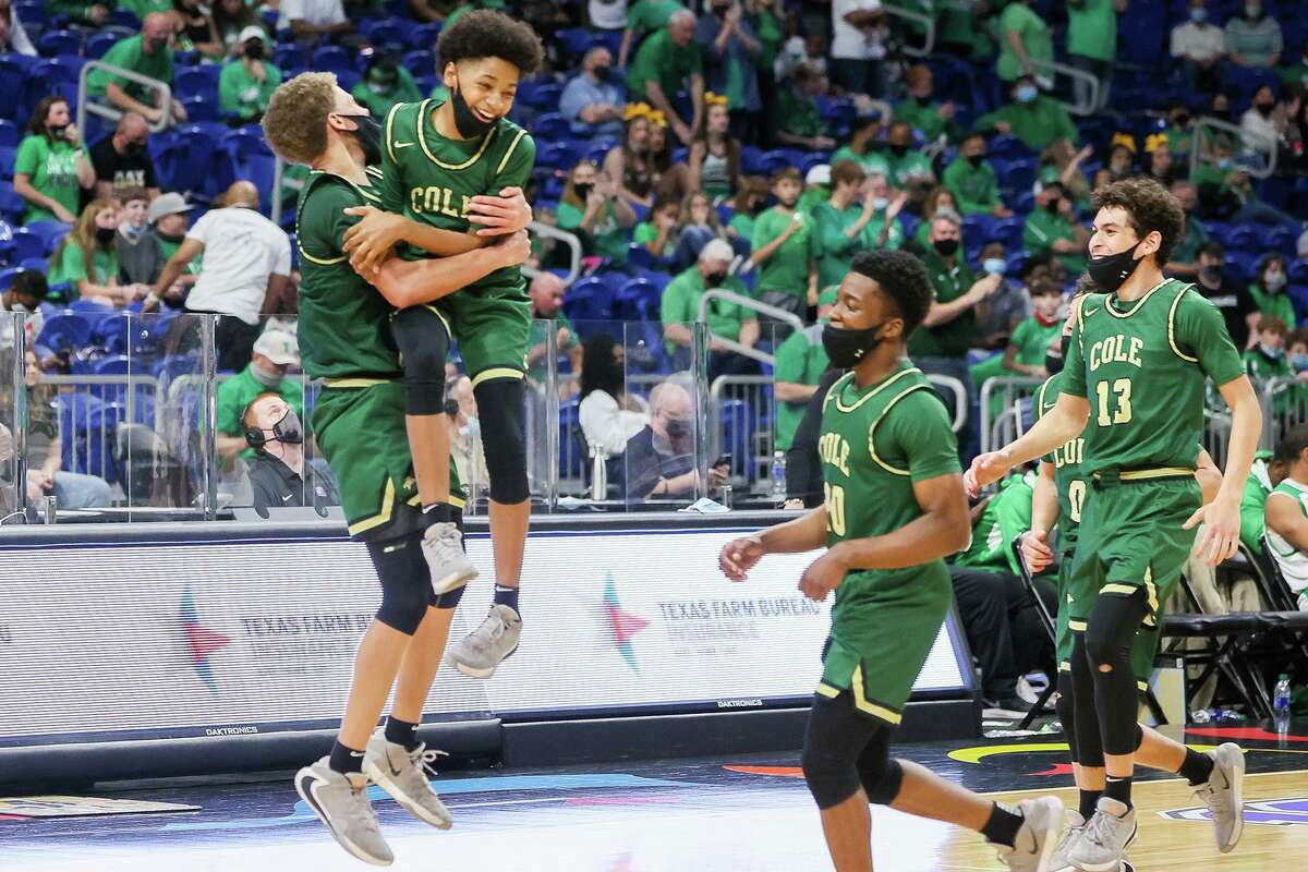 Coles Trey Blackmore, left, celebrates with Silas Livingston at the conclusion of their Class 3A boys basketball state championship game with Tatum at the Alamodome on Friday, March 12, 2021. Cole beat Tatum 77-60.