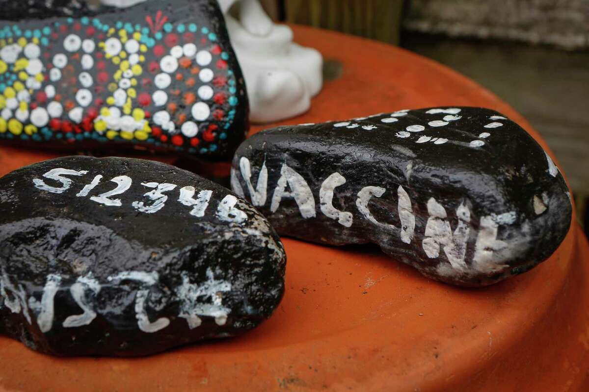 Sandy Dwyer painted stones that marked each month of the pandemic and placed them in her memorial garden Thursday, March 11, 2021, in Houston.
