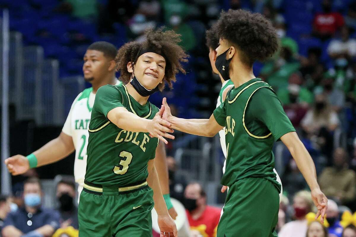 Cole's Lucas Veras, left, celebrates a play with Silas Livingston during the second half of their Class 3A boys basketball state championship game with Tatum at the Alamodome on Friday, March 12, 2021. Cole beat Tatum 77-60.