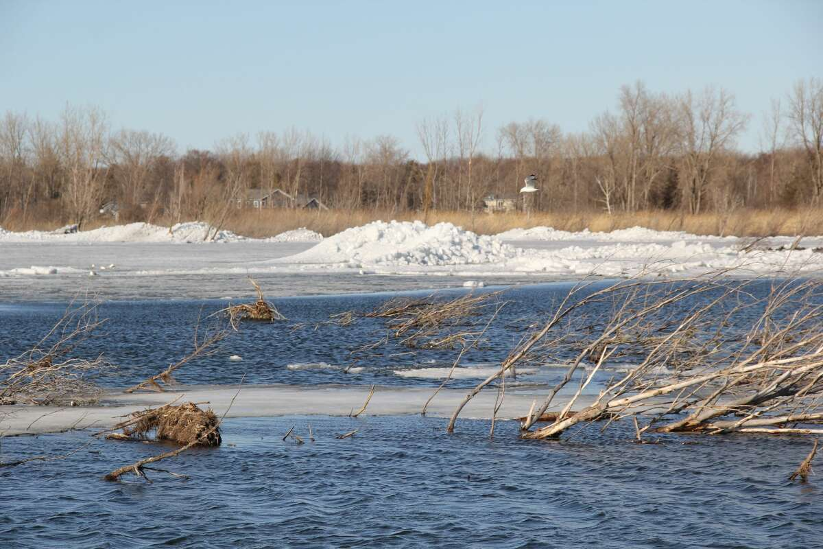 Piles of ice were found ashore at the Filion Road Public Access for boats south of Sand Point on Friday afternoon. The ice comes as temperatures are expected to cool off from the heatwave of earlier this week.