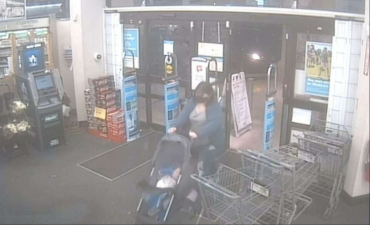 An image taken from security camera footage shows Dlanny Chairez, 20, entering a drugstore Jan. 4 in the 7100 block of Marbach Road. She was with her 18-month-old son, James Avi Chairez. Both of them are missing, San Antonio police say.