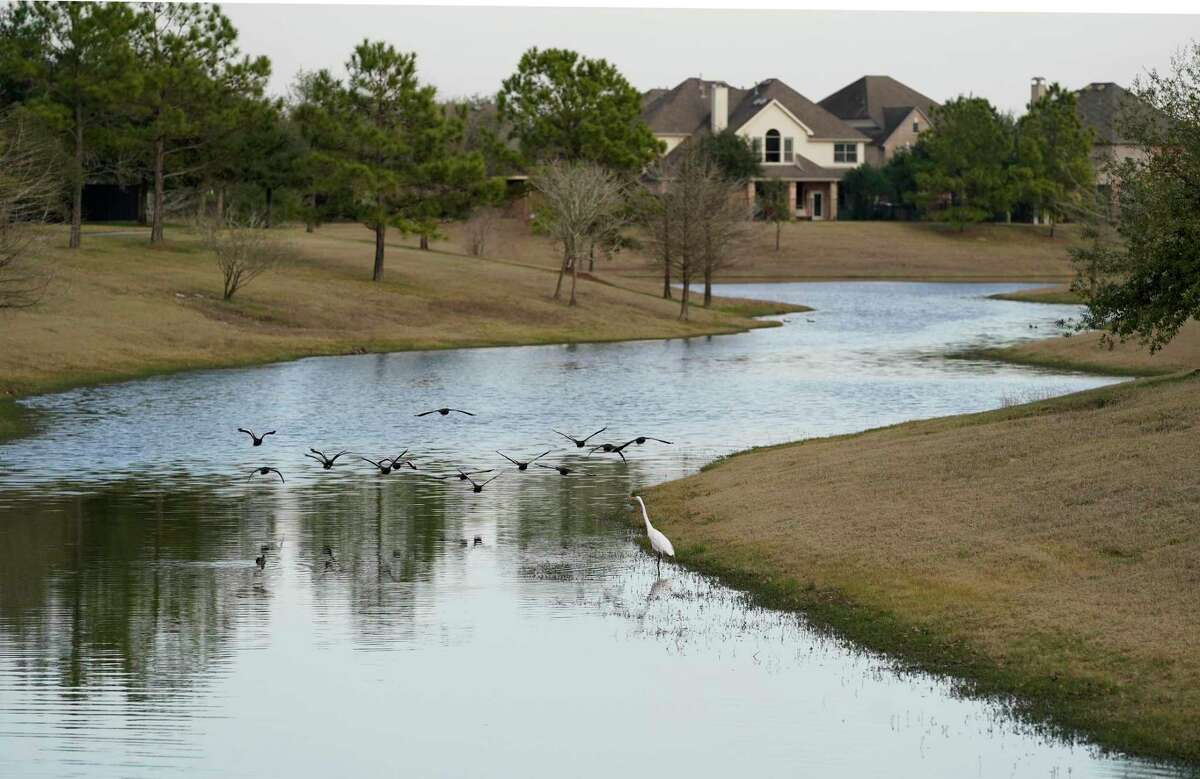 A waterway is shown in Bridgeland Thursday, Jan. 28, 2021 in Cypress. The master-planned community has invested millions in a series of lakes to hold storm water. They credit the investment with preventing the community from flooding during Tax Day and Hurricane Harvey. They are also considering installing sensors and pumps so that detention ponds can be lowered before a heavy rain, allowing it to hold more stormwater.