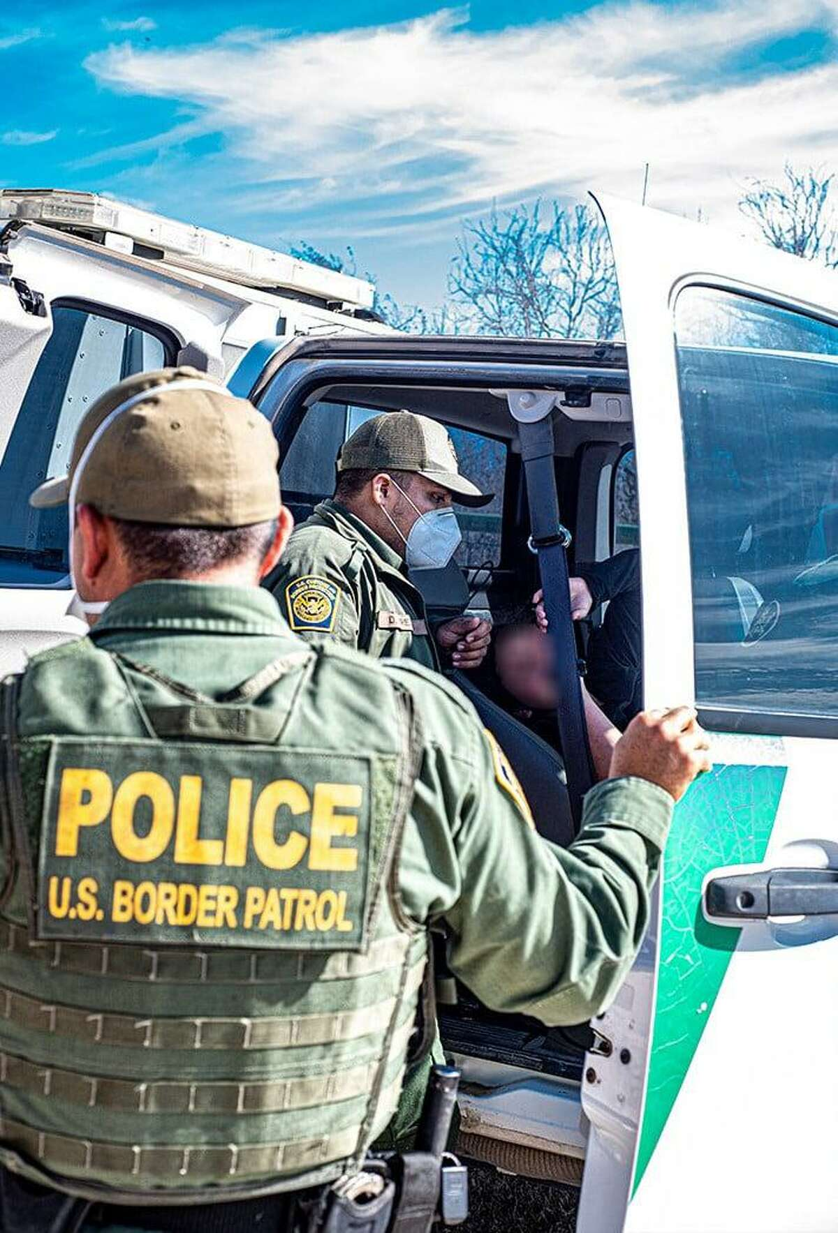 U.S. Border Patrol agents rendered aid to an immigrant who was suffering from dehydration and long exposure. She was found with a group of immigrants near Hebbronville.