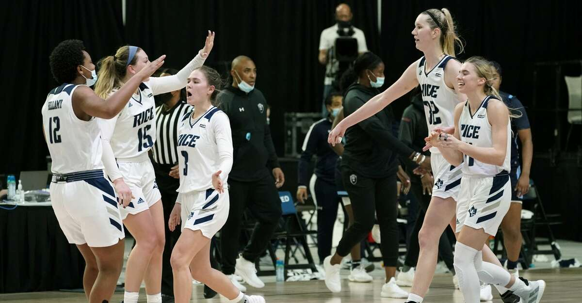 Rice players celebrate at the end of an NCAA college basketball game against Old Dominion in the Conference USA women's tournament, Friday, March 12, 2021, in Frisco, Texas. Rice won 62-60. (AP Photo/Tony Gutierrez)