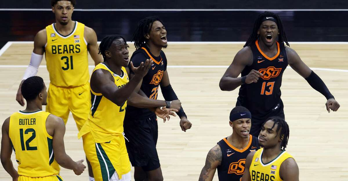 Kalib Boone #22, Isaac Likekele #13 and Avery Anderson III #0 of the Oklahoma State Cowboys celebrate as the Cowboys defeat the Baylor Bears 83-74 to win the Big 12 basketball tournament semifinal game at the T-Mobile Center on March 12, 2021 in Kansas City, Missouri. (Photo by Jamie Squire/Getty Images)