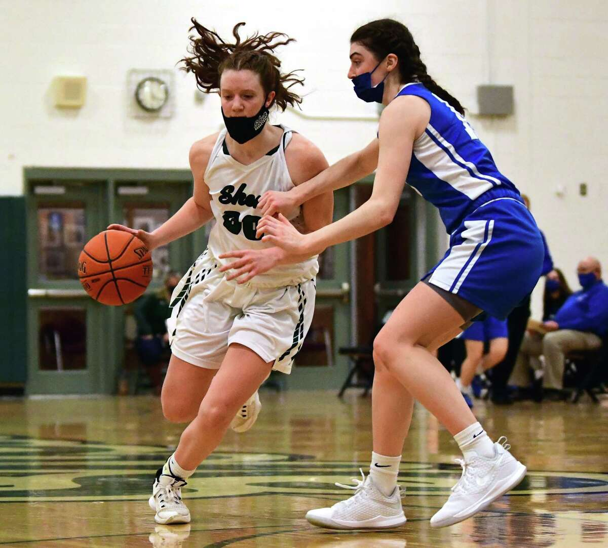 Shenendehowa's Jillian Huerter is defended by Saratoga's Nora Carminucci during a basketball game on Friday, March 12, 2021 in Clifton Park, N.Y. (Lori Van Buren/Times Union)