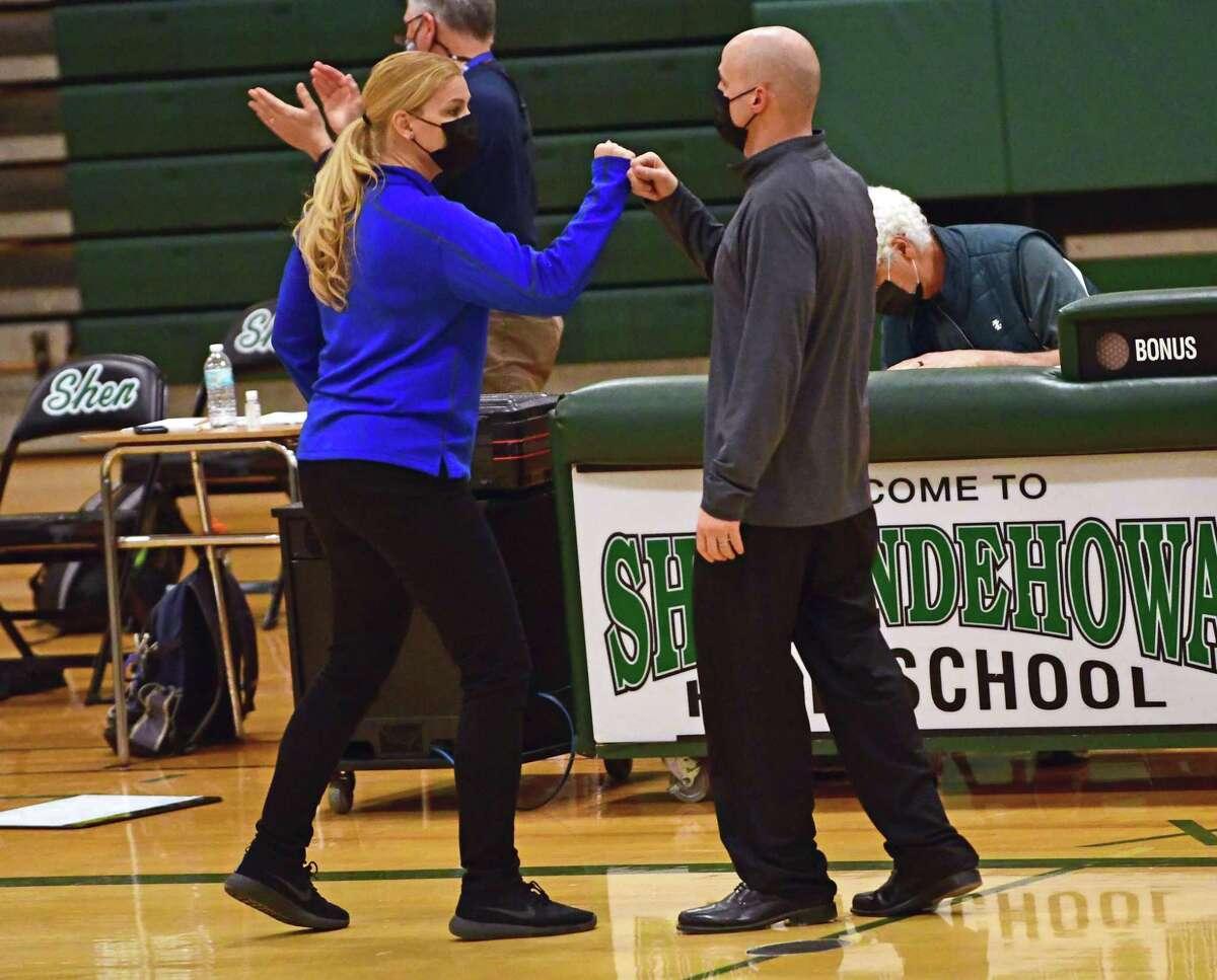 Saratoga head coach Robin Chudy gets a fist bump from Shenendehowa head coach Joe Murphy after the Shenendehowa girls defeated Saratoga in a final game on Friday, March 12, 2021 in Clifton Park, N.Y. (Lori Van Buren/Times Union)