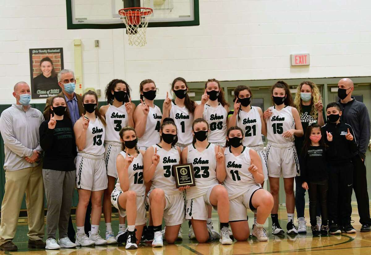 The Shenendehowa girls basketball team poses with their championship plaque after defeating Saratoga in a final game on Friday, March 12, 2021 in Clifton Park, N.Y. (Lori Van Buren/Times Union)