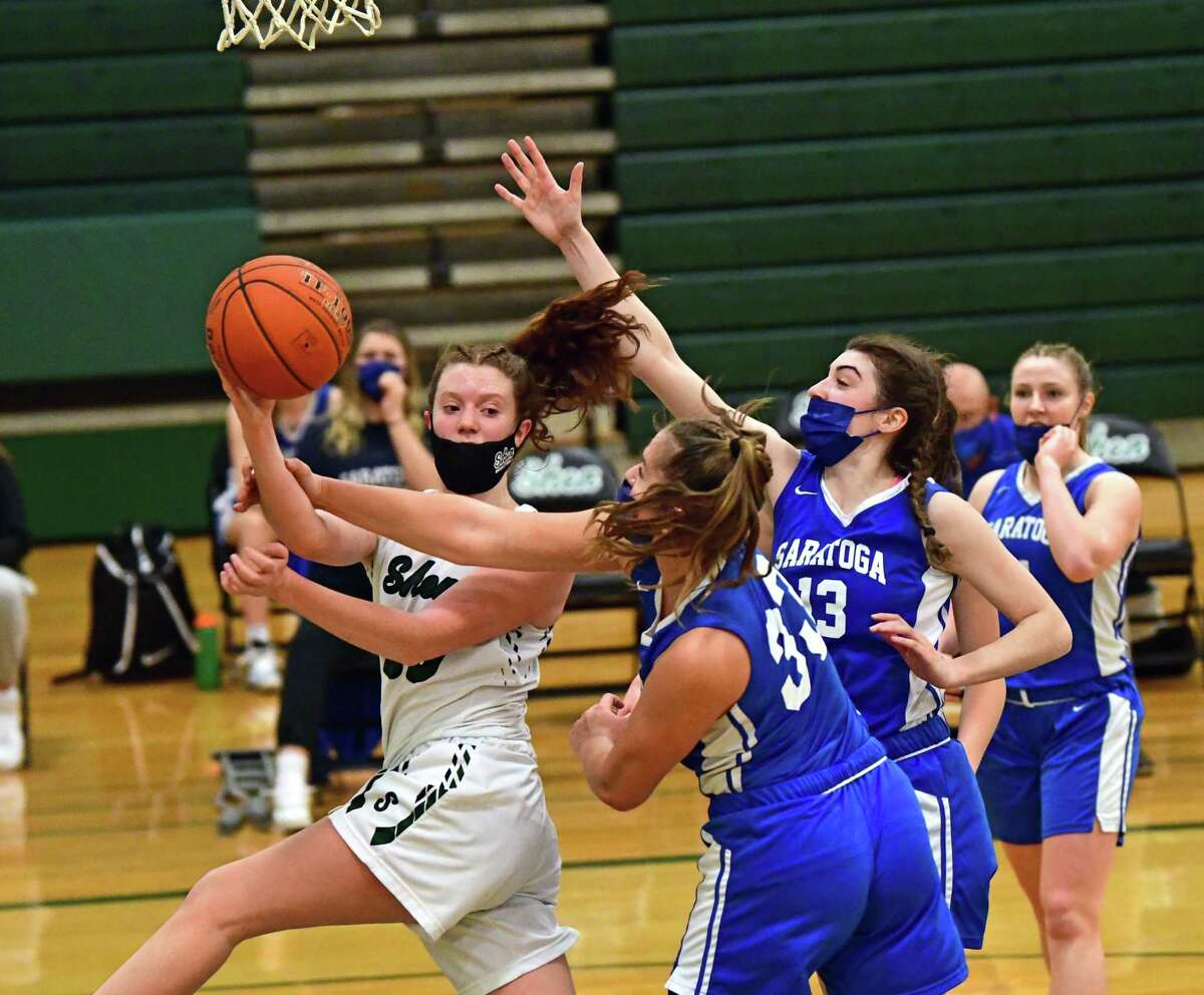 Shenendehowa's Jillian Huerter passes the ball out to a teammate as she drives to the hoop during a basketball game against Saratoga on Friday, March 12, 2021 in Clifton Park, N.Y. (Lori Van Buren/Times Union)
