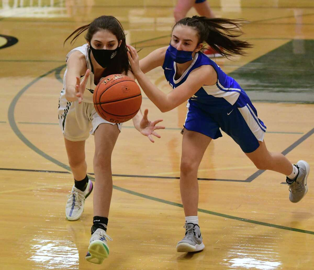 Shenendehowa's Sarah Jacques and Saratoga's Ella Spain battle over a loose ball during a basketball game on Friday, March 12, 2021 in Clifton Park, N.Y. (Lori Van Buren/Times Union)
