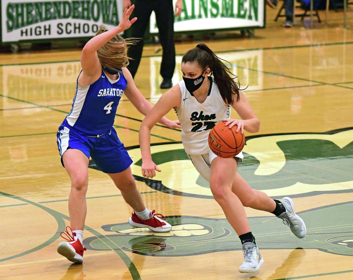 Shenendehowa's Meghan Huerter drives to the basket defended by Saratoga's Abby Ray during a basketball game on Friday, March 12, 2021 in Clifton Park, N.Y. (Lori Van Buren/Times Union)