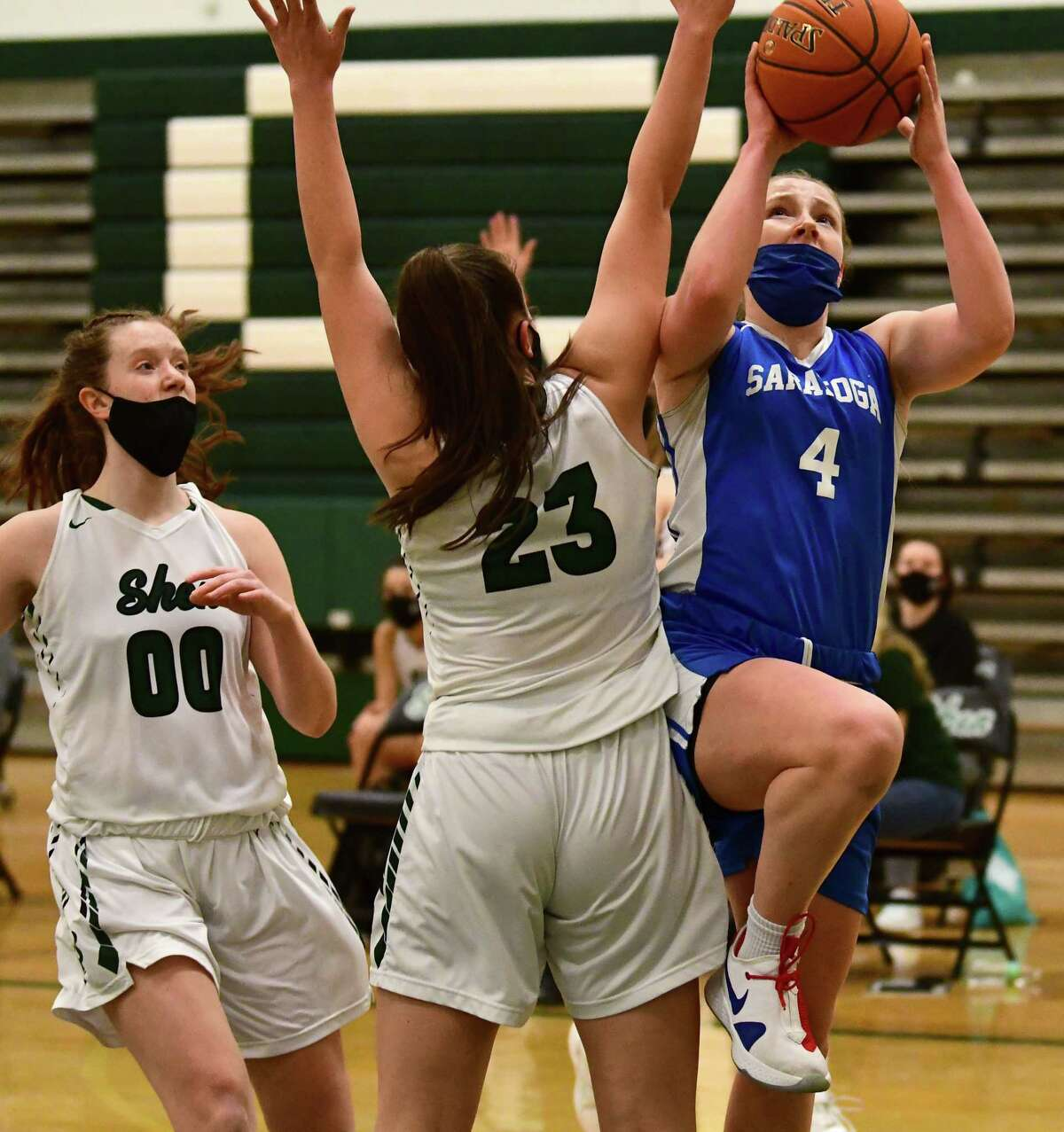 Saratoga's Abby Ray takes a shot defended by Shenendehowa's Meghan Huerterduring a basketball game on Friday, March 12, 2021 in Clifton Park, N.Y. (Lori Van Buren/Times Union)