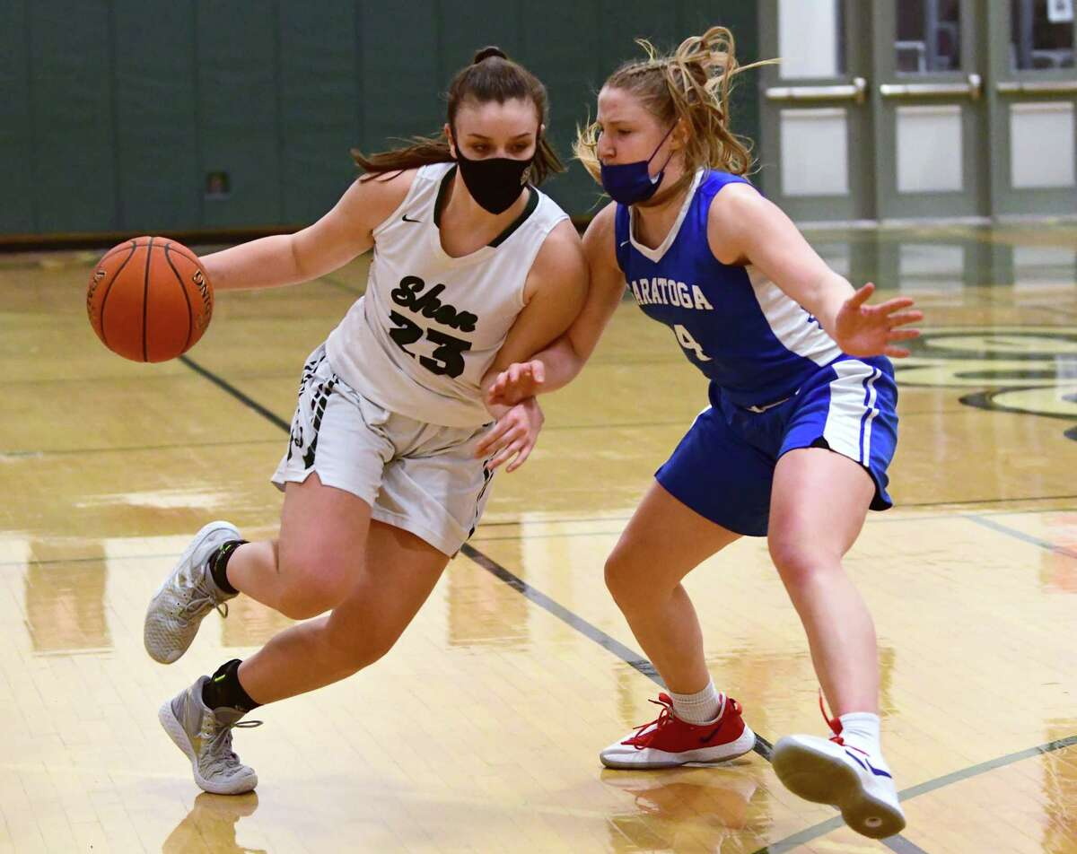 Shenendehowa's Meghan Huerter is defended by Saratoga's Abby Ray during a basketball game on Friday, March 12, 2021 in Clifton Park, N.Y. (Lori Van Buren/Times Union)