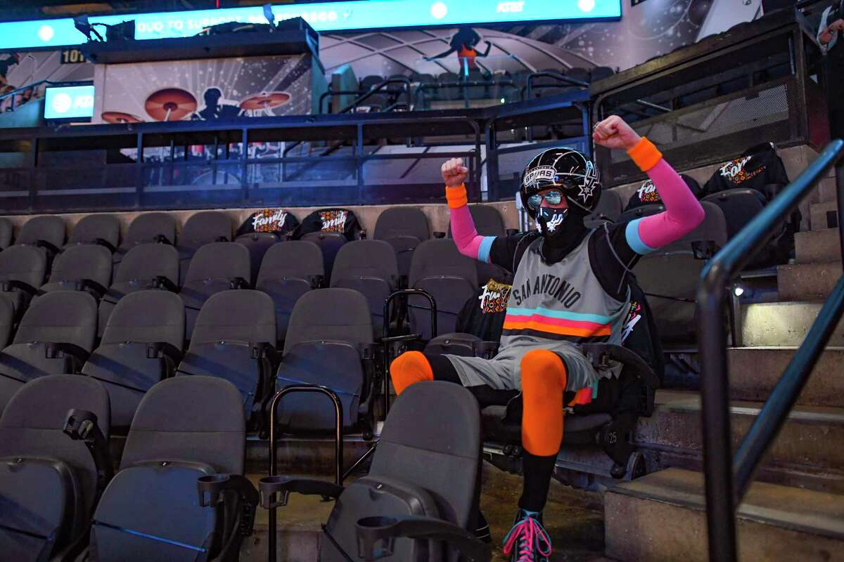 """Mark Burnett, known as the """"Sixth Man,"""" is eager for the Spurs game to start at AT&T Center on Friday night. The coronavirus pandemic, up until Friday, had closed the team's games to the public."""
