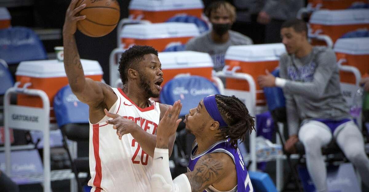 Houston Rockets center Justin Patton (26) is defended by Sacramento Kings center Richaun Holmes (22) during the second half of an NBA basketball game in Sacramento, Calif., Thursday, March 11, 2021. The Kings won 125-105. (AP Photo/Randall Benton)