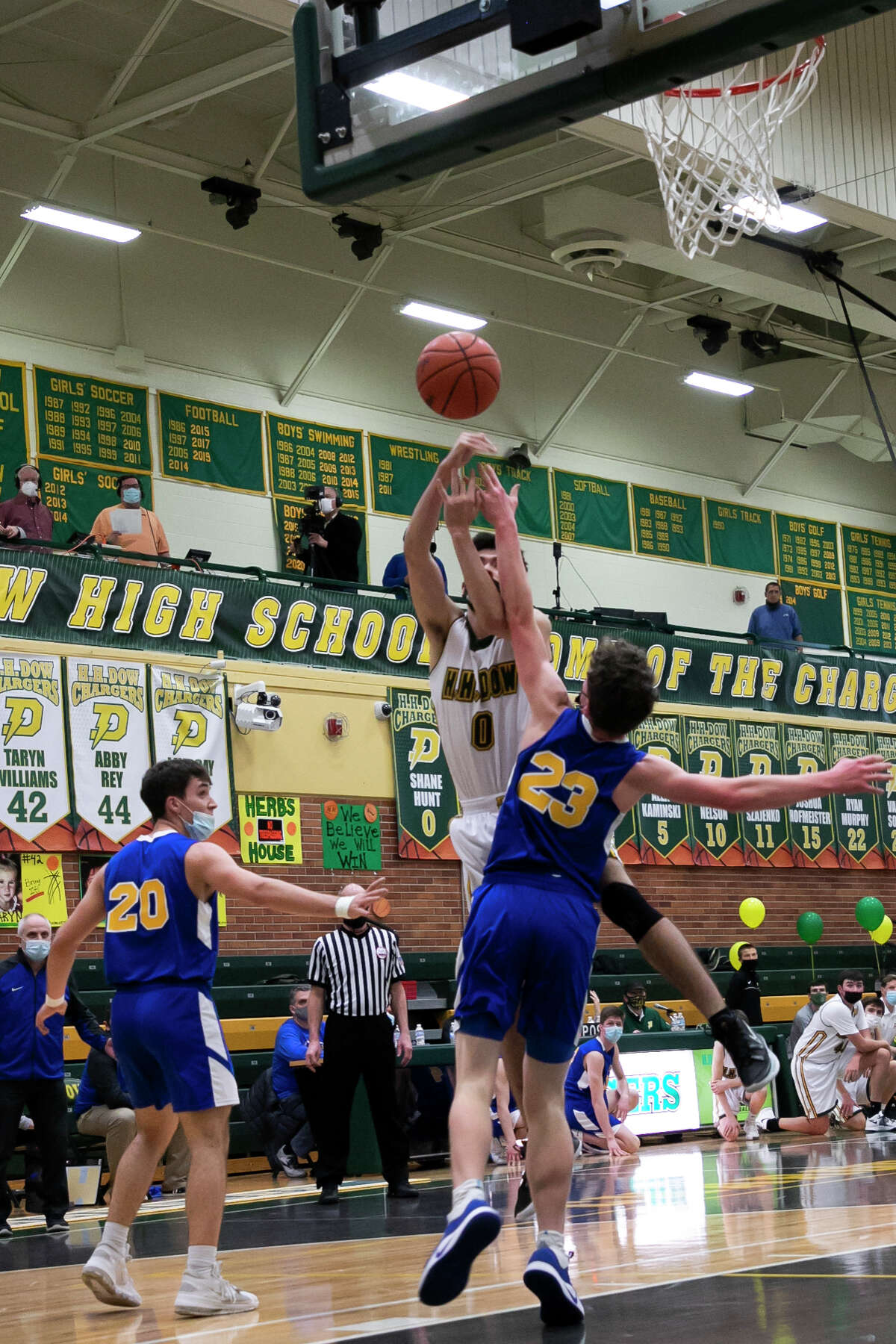 Dow's Shane Hunt takes a shot during a game against Midland Friday, March 12, 2021 at H. H. Dow High School. (Doug Julian/for the Daily News)