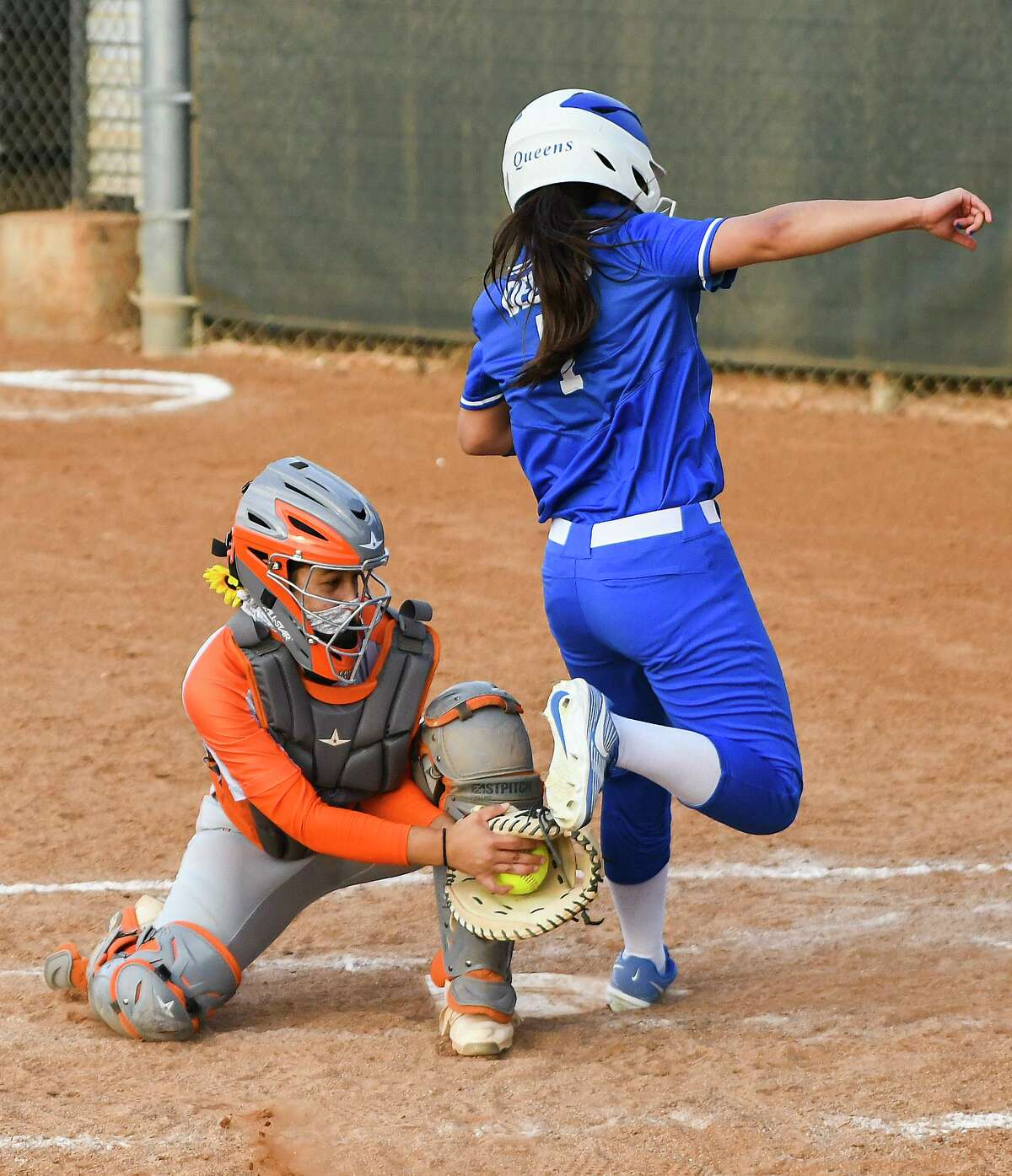 United's Kaylie Ferrezano goes for the tag at home plate Friday at the SAC. The Lady Longhorns improved to 2-1 with a 12-5 victory over Del Rio.