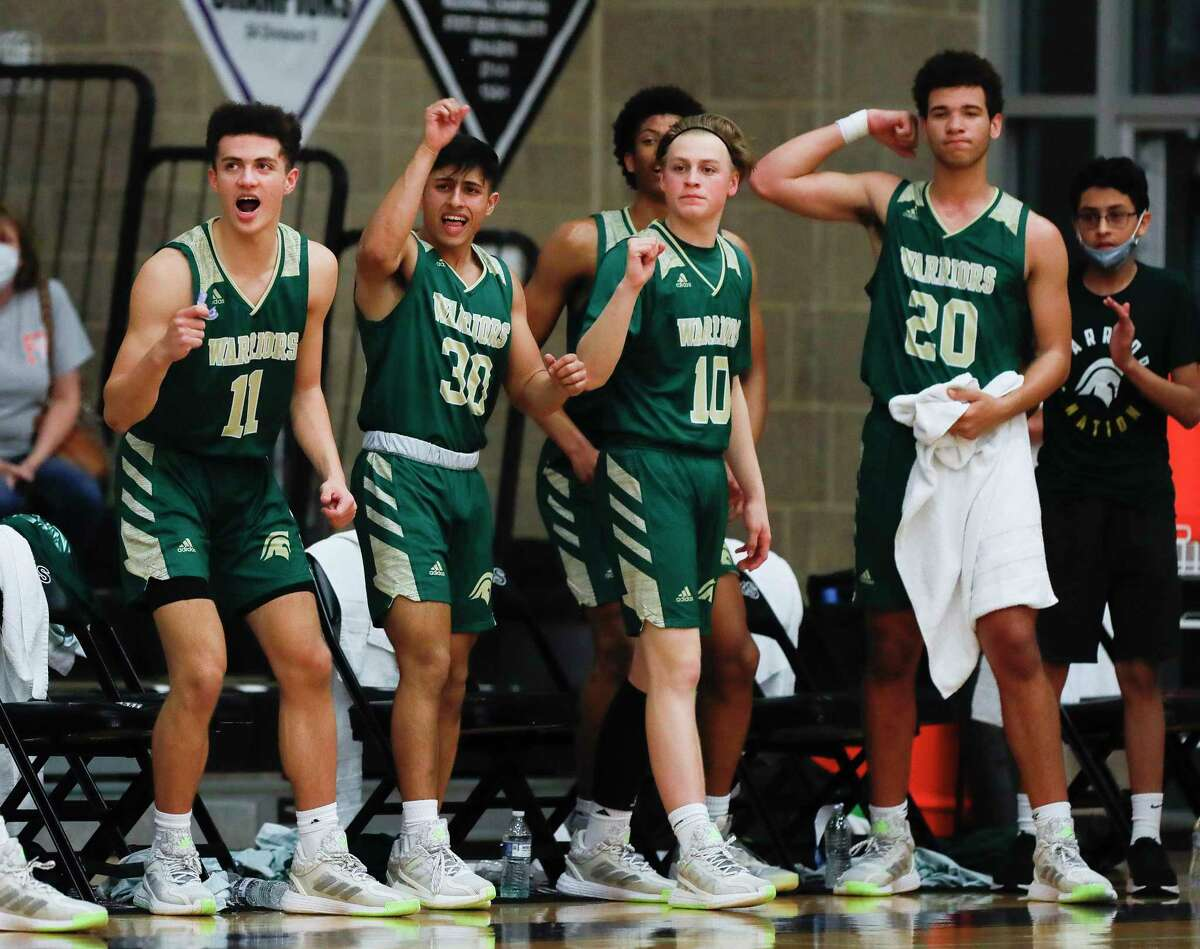 The Woodlands Christian Academy players react to a 3-pointer during the first quarter of a TAPPS Class 5A state championship game at College Station High School, Friday, March 12, 2021, in College Station.