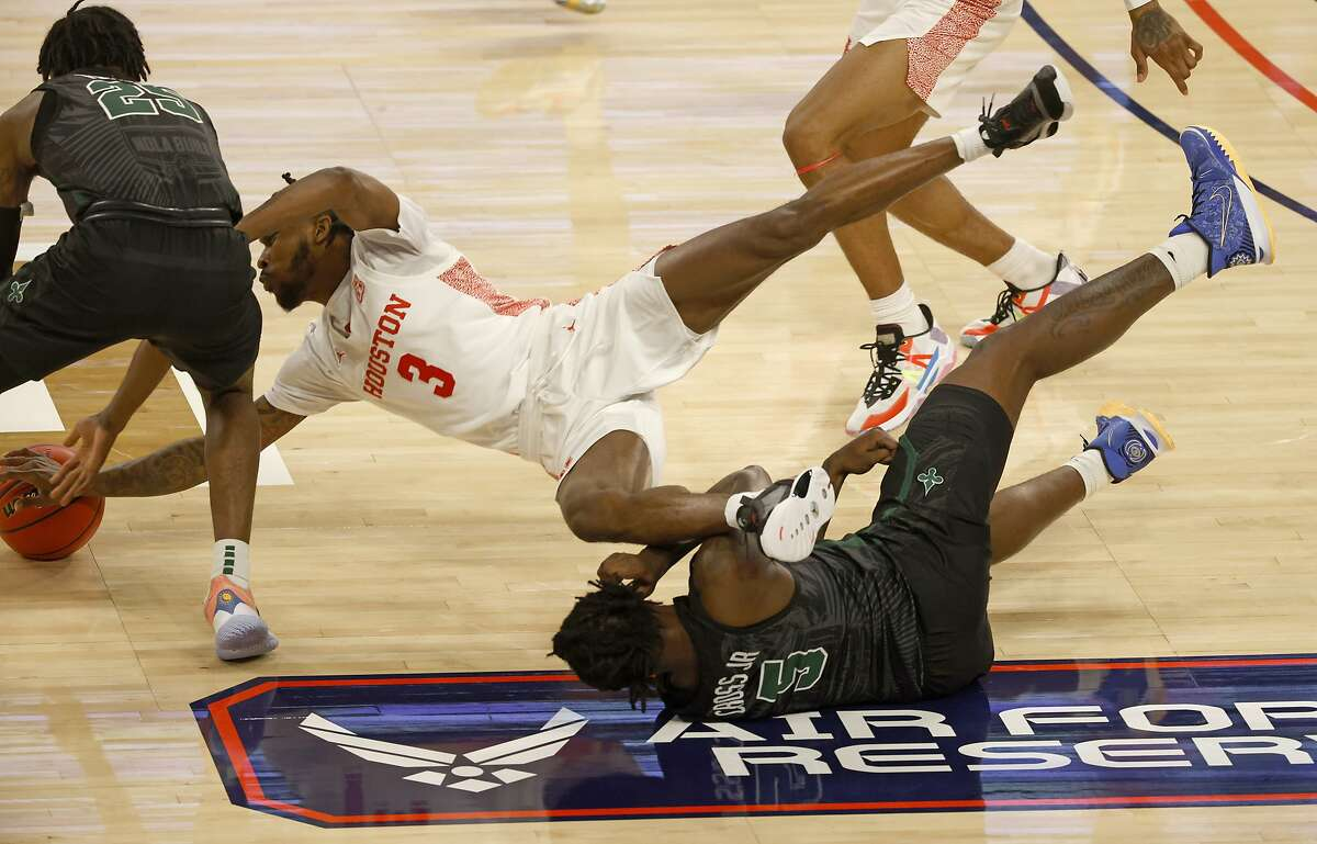 Houston guard DeJon Jarreau (3) dives over Tulane's Kevin Cross (5) to battle Jaylen Forbes (25) for the ball. Jarreau had his first triple-double.