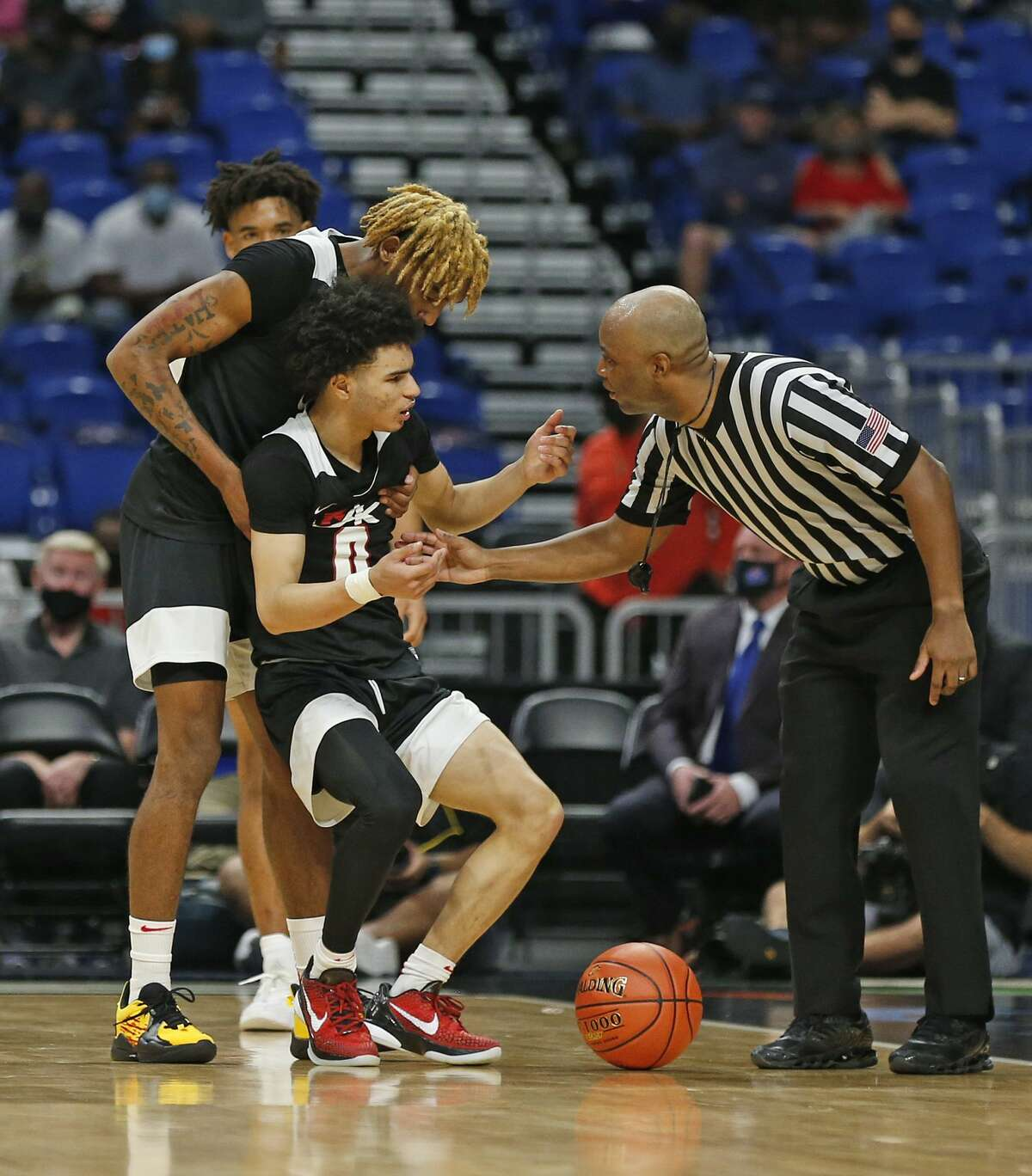 Dallas Kimball Arterio Morris #2 helps up Dallas Kimball Jayden Blair #0 after he tied up a player and thought his team would get possession. UIL boys Class 5A basketball state championship game on Friday, March 12, 2021 at the Alamodome.