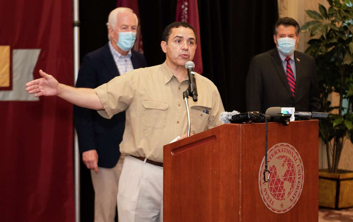 Rep. Henry Cuellar, joined by Sen. John Cornyn, speaks on the topic of immigration during a press conference, March 12, 2021, after a round table discussion at the TAMIU Student Center Ballroom.