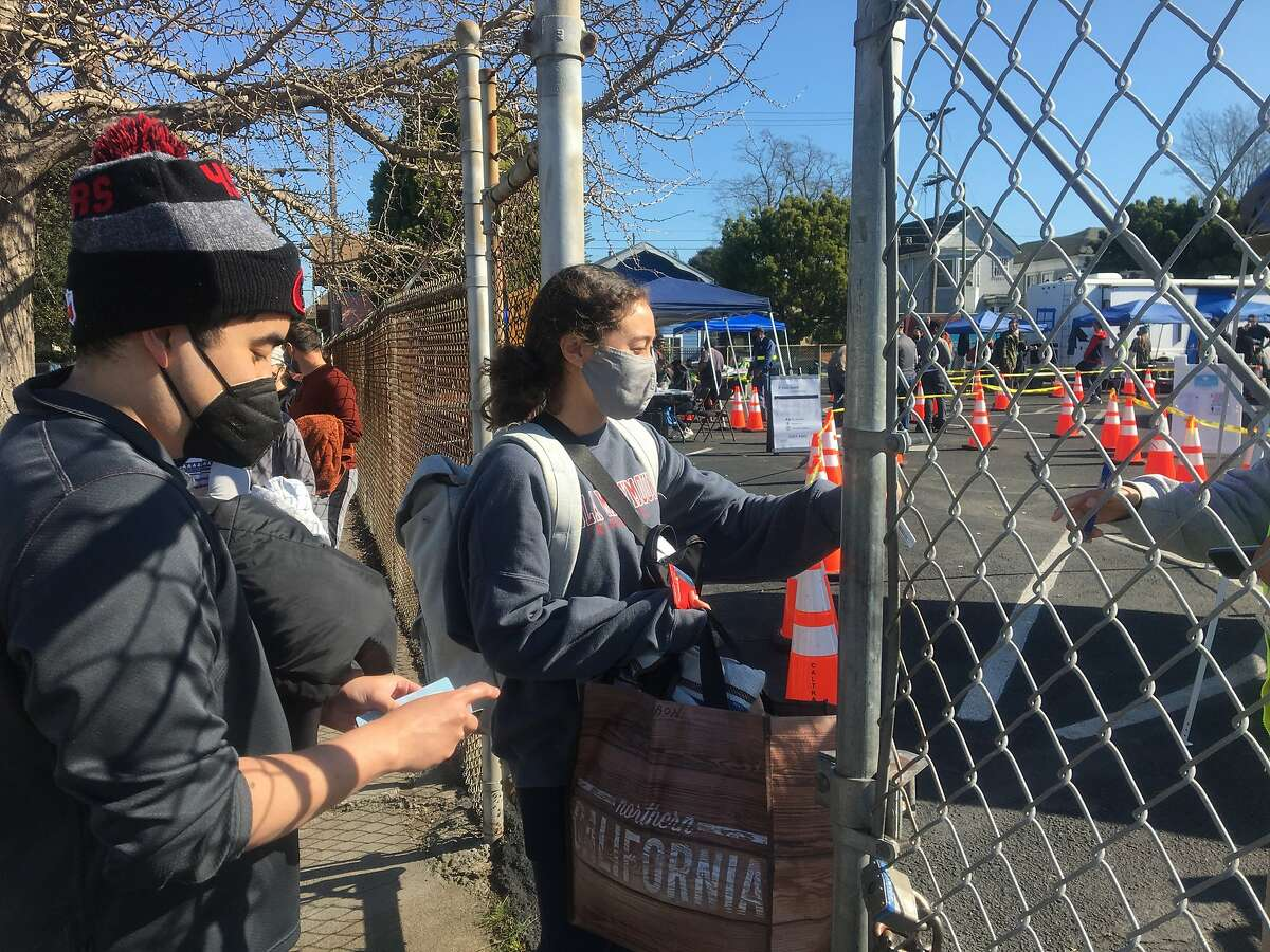 Thousands of people on Friday showed up to a first-come, first-serve vaccination clinic in West Oakland that was intended to search Black and Latino populations in the neighborhood.