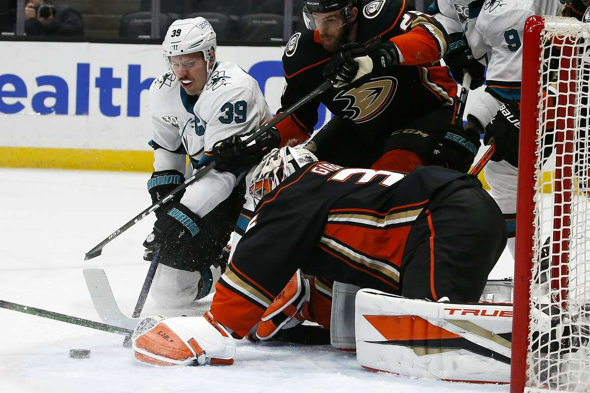 Ducks goalie John Gibson protects the net against Sharks forward Logan Couture (39) in the first period of a 5-0 win in Anaheim.