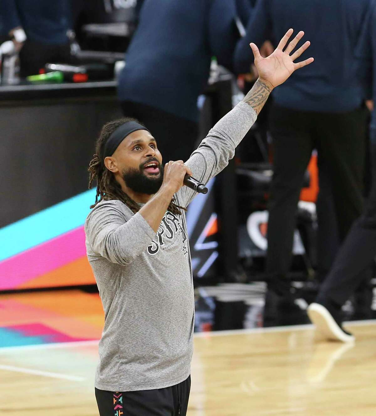 Spurs' Patty Mills welcomes back fans before the game against the Orlando Magic at the AT&T Center on Friday, Mar. 12, 2021. The game was the first time for fans to return to the arena since the start of the Covid-19 pandemic last year.