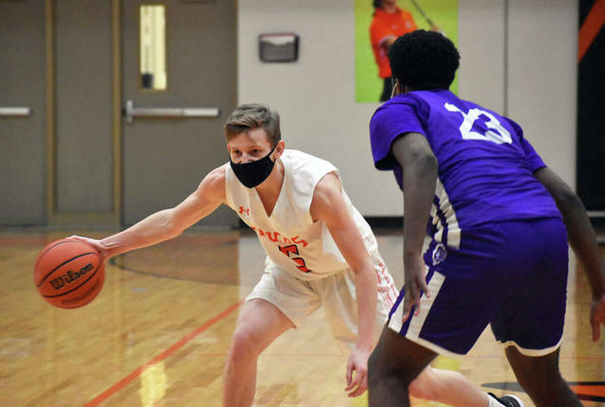In this file photo, Edwardsville senior guard Preston Weaver delivers a pass to a teammate during a home game against Collinsville. On Friday, Weaver scored the game-winning basket with 1.5 seconds remaining against Belleville West.