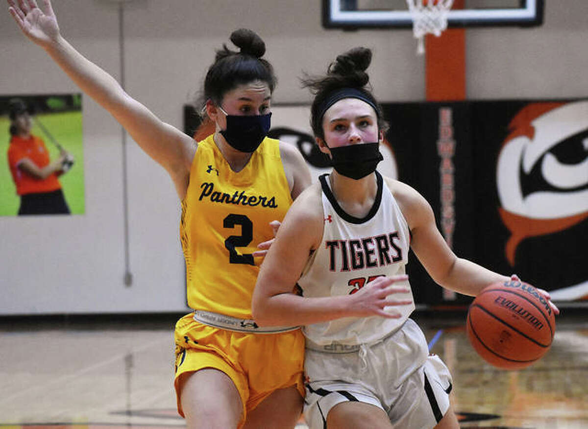 In this file photo, EHS junior guard Macy Silvey, right, drives to the basketball against O'Fallon earlier this season in Edwardsville. On Friday, Silvey had a game-high 13 points in the win over Belleville West.