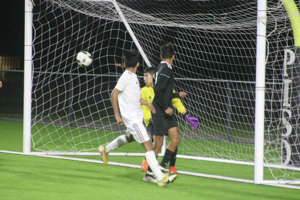 All held their breath as a Deer Park second-half corner kick bounces harmlessly past Memorial's net Friday night.