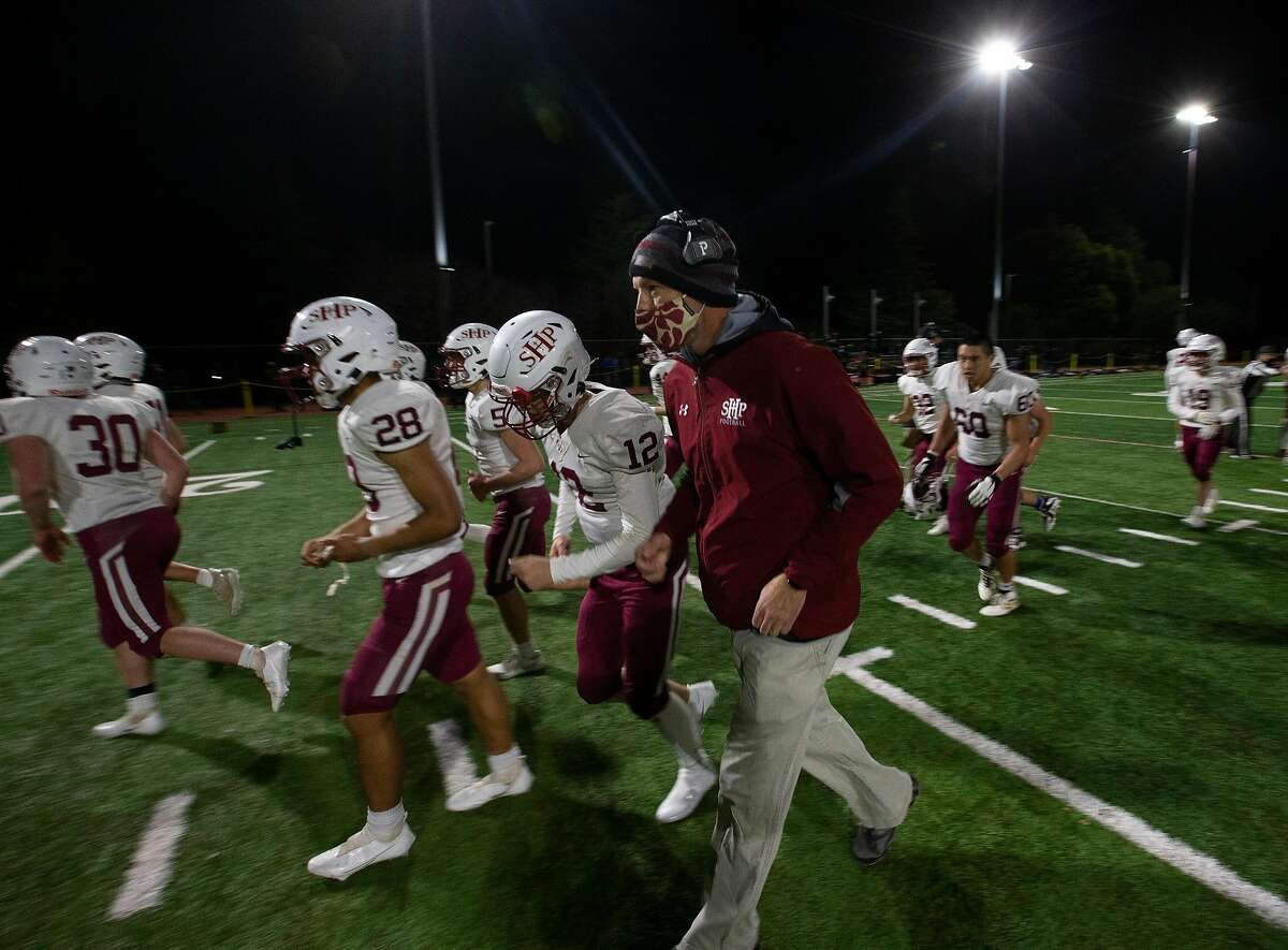 Sacred Heart Prep head coach Mark Grieb leads his team off the field following their season-opening victory over Aragon on Friday night.