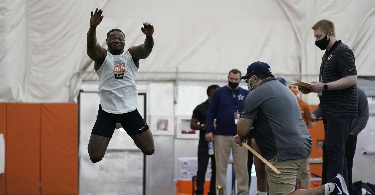 Texas defensive back Chris Brown goes through drills during the school's Pro Day, Thursday, March 11, 2021, in Austin, Texas. (AP Photo/Eric Gay)