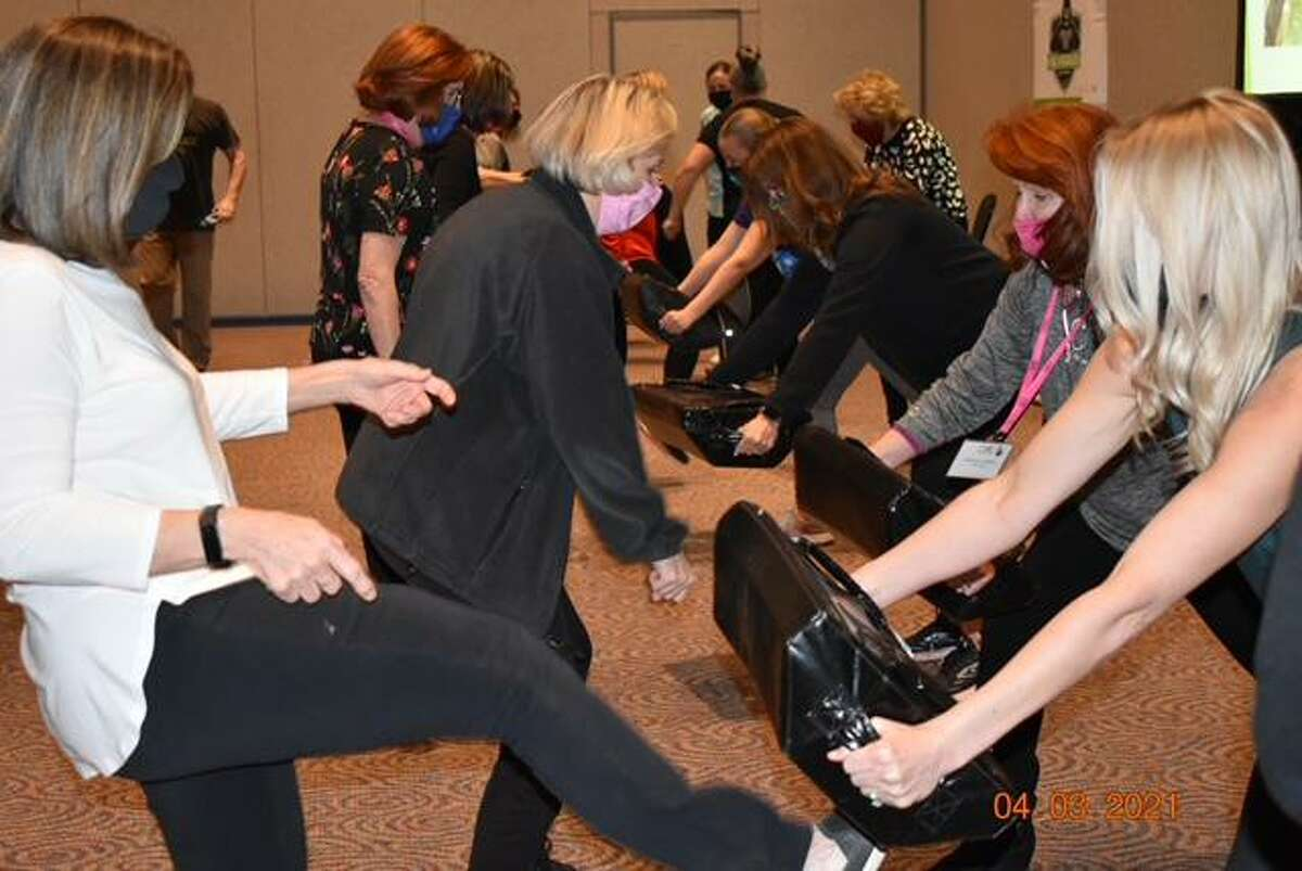 Cy-Fair Women's Club hosts programs at meetings covering topics including self defense.