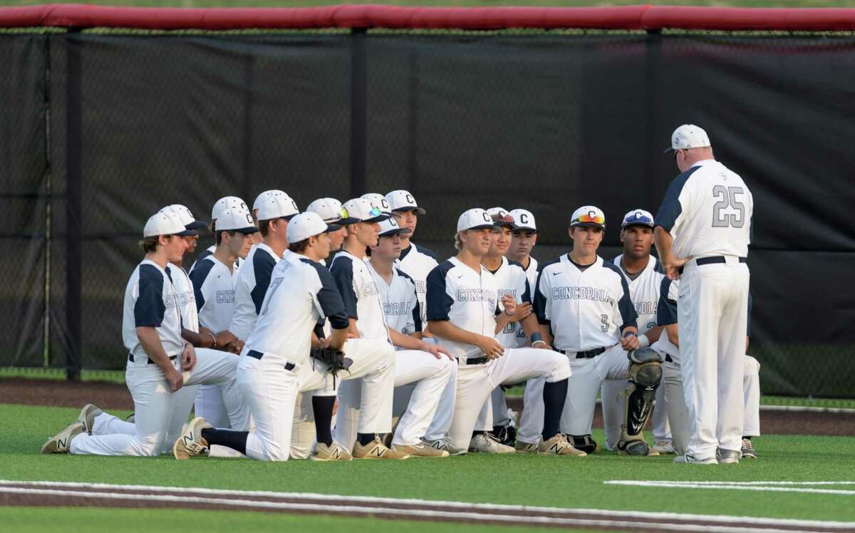 Concordia Lutheran Crusaders Head Coach, Rick Lynch talks to his team prior to their game with the St. Pius X Panthers in a TAPPS baseball playoff game on Wednesday, May 10, 2017 at the Crosby High School Baseball Field in Crosby, Texas.
