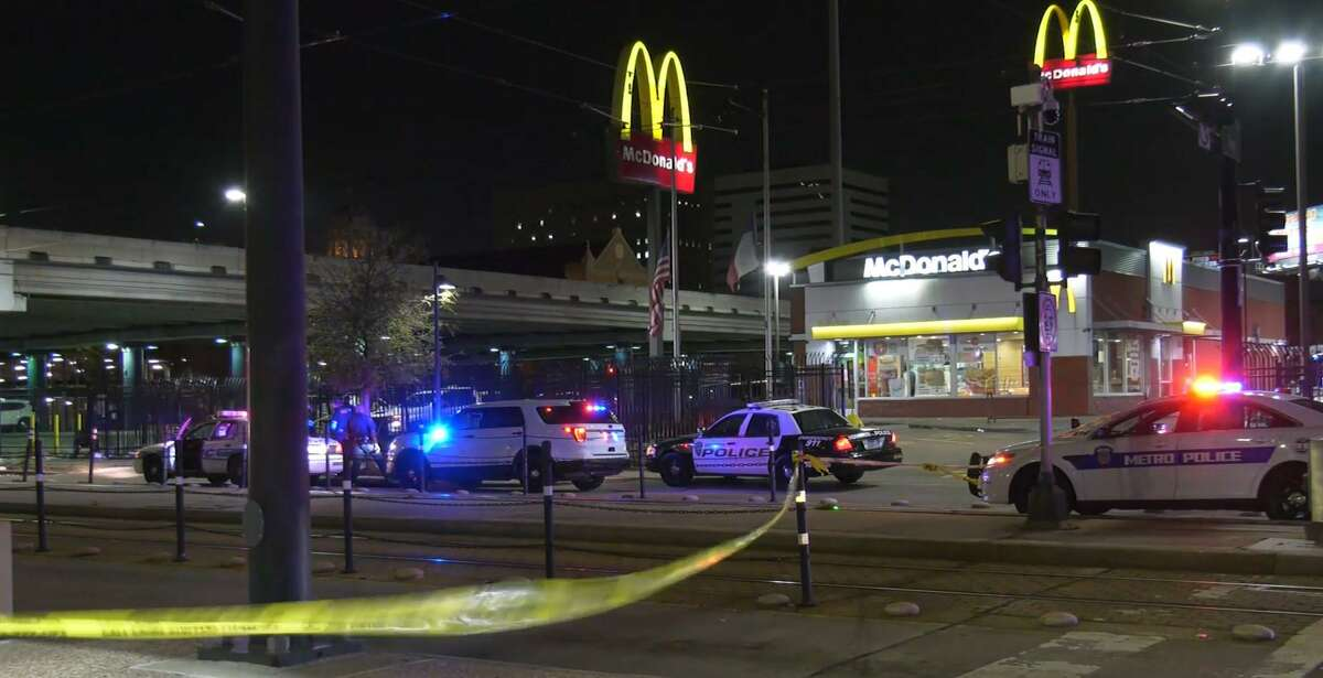 Houston police investigators work the scene of a fatal shooting Friday night at a Midtown McDonald's located near Main and Gray streets.