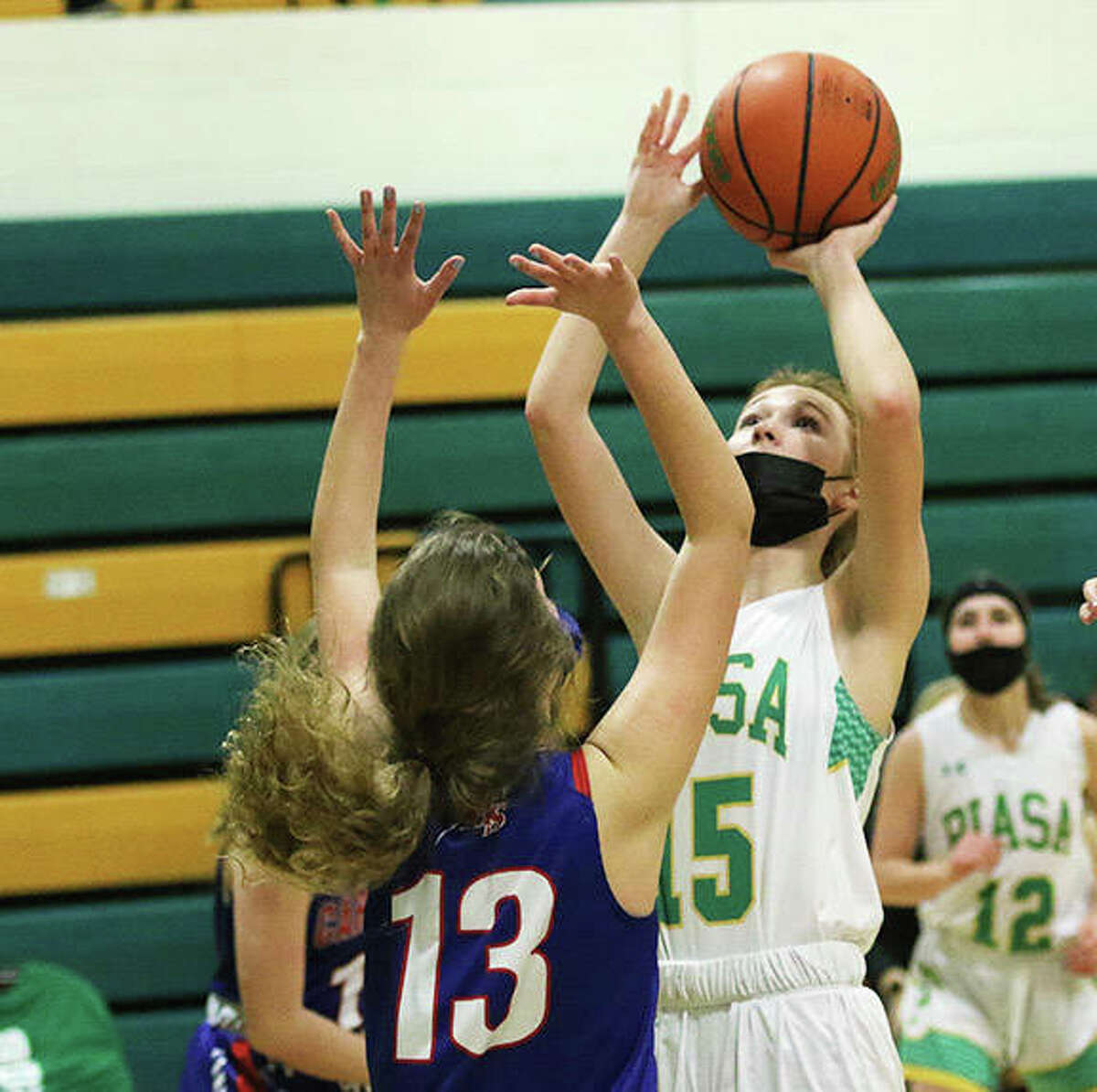 Southwestern's Hannah Nixon, shown shooting over Carlinville's Melanie Murphy (13) in a SCC game earlier this season in Piasa, scored eight points Friday night in the Birds' win at North Greene in White Hall. Nixon will be the lone returning starter back from a Southwestern team that finished 12-1 with a SCC championship in 2021.