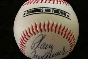 "When Michael Lang asked baseball legend Tom Seaver to sign a baseball ""Just Plain Tom Seaver,"" he got it back with the words ""Plain Tom Seaver."""