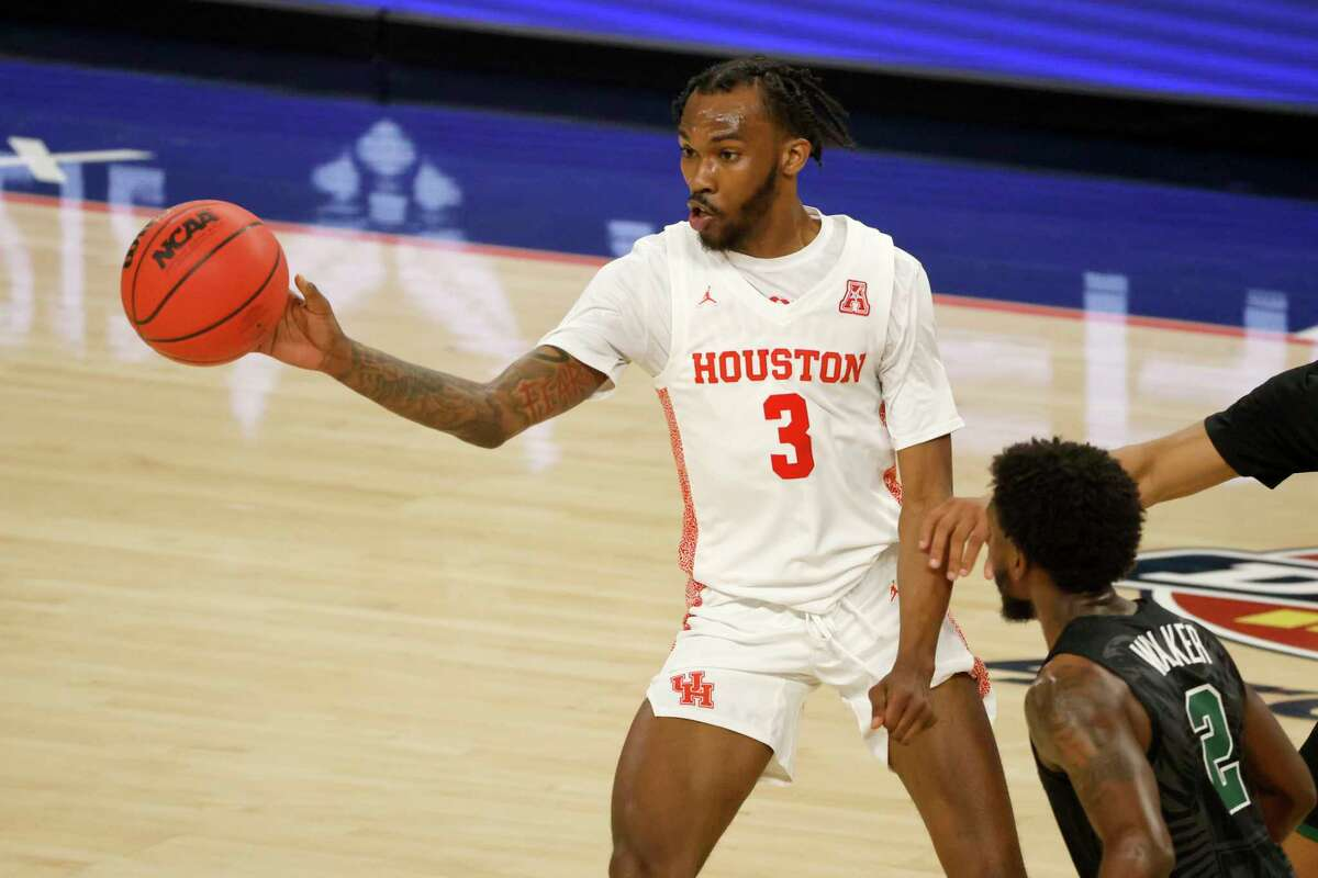 Houston guard DeJon Jarreau (3) handles the ball against Tulane during the second half of an NCAA college basketball game in the quarterfinal round of the American Athletic Conference men's tournament Friday, March 12, 2021, in Fort Worth, Texas. (AP Photo/Ron Jenkins)