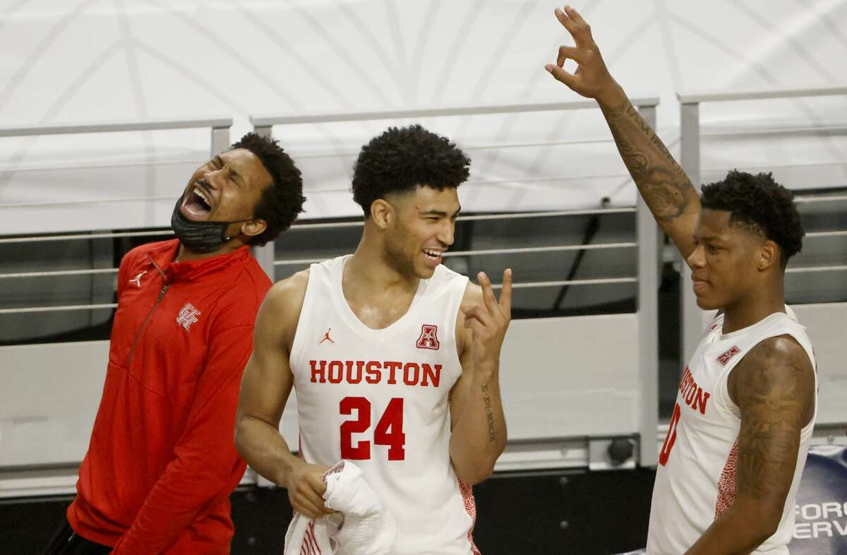 Houston guards Quentin Grimes (24) and Marcus Sasser (0) along with the Houston bench react in the final minute against Tulane during the second half of an NCAA college basketball game in the quarterfinal round of the American Athletic Conference men's tournament Friday, March 12, 2021, in Fort Worth, Texas. (AP Photo/Ron Jenkins)