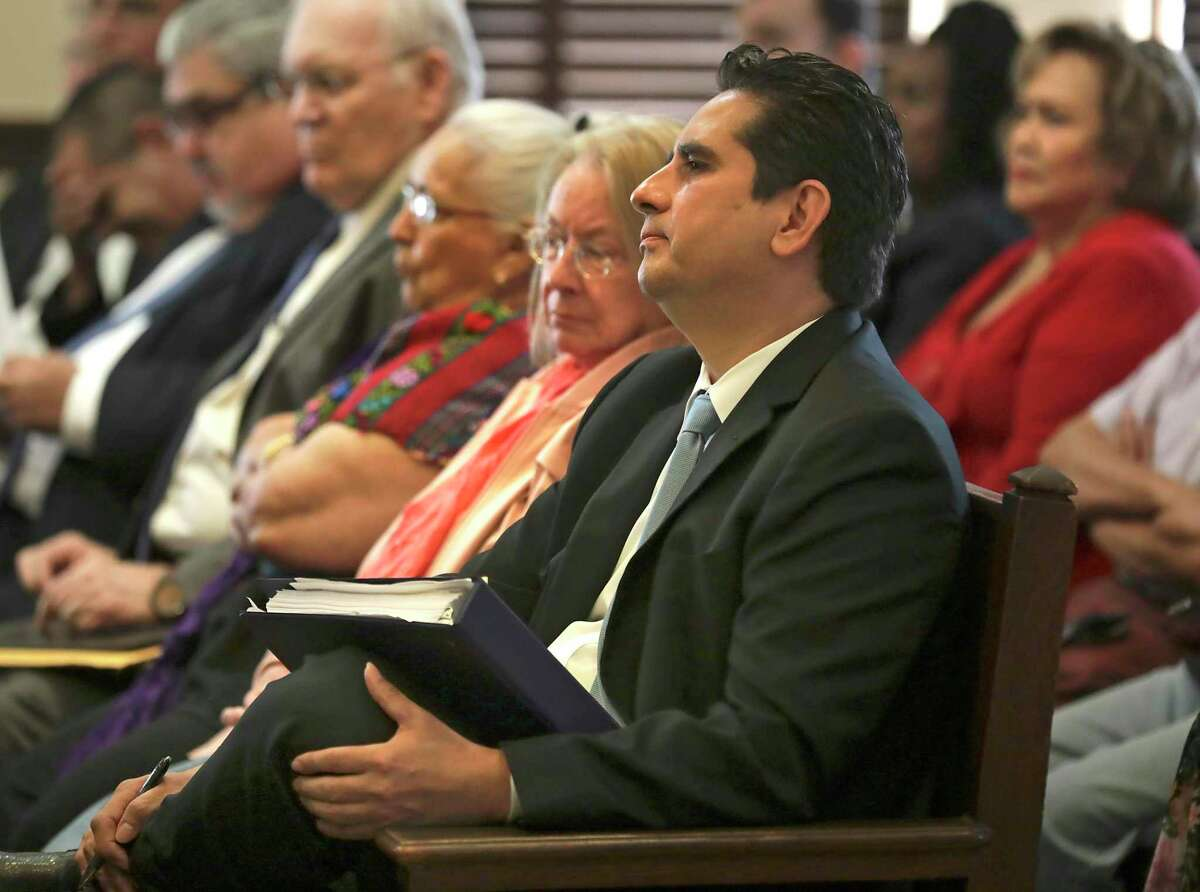 """Manuel Medina, former Bexar County Democratic Party chair sits with his supporters, the """"Manuelistas"""" in the Bexar County Courthouse for a civil suit against current Chair Monica Alcantara, on Monday, April 22, 2019."""