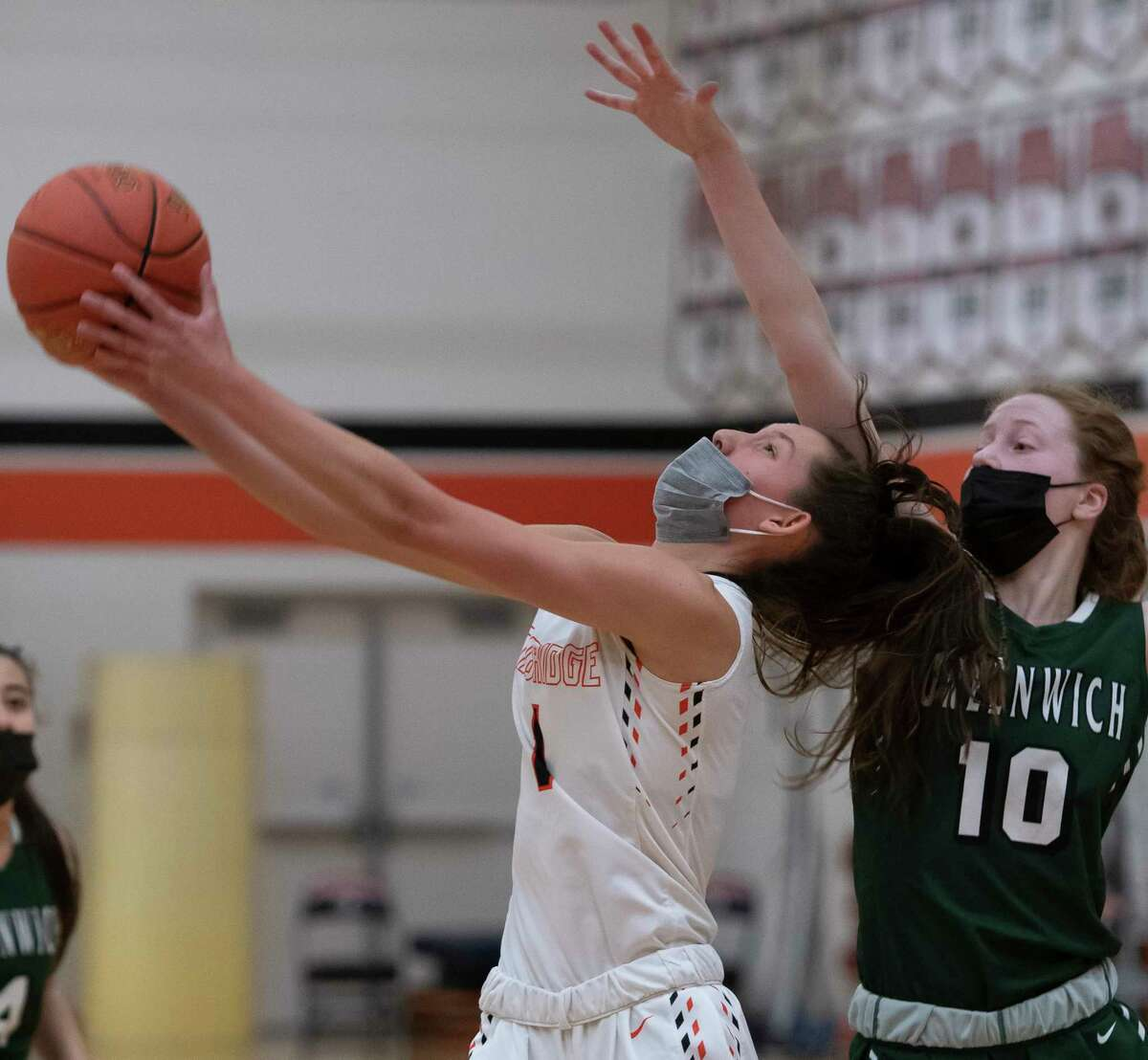 Cambridge's Lilly Phillips, left, is defended by Greenwich's Molly Brophy, both members of the Times Union Small-School Girls' Basketball all-star team. (Jenn March, Special to the Times Union)