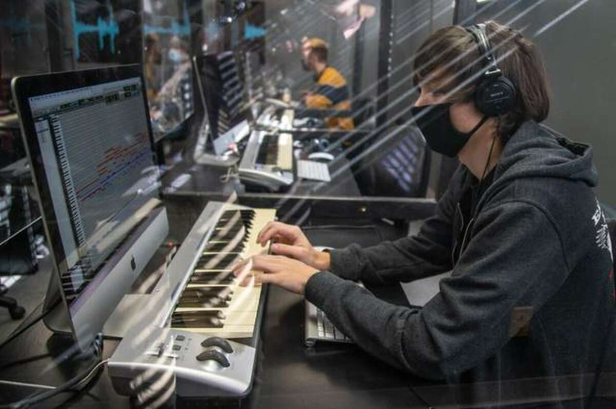 Cameron Goey, a freshman working toward an associate degree in Music Production, studies behind plexiglass in a Lewis and Clark Community College Music Department classroom, located under the Benjamin Godfrey Memorial Chapel.