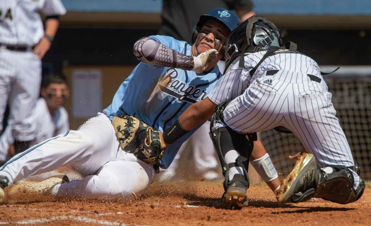 Greenwood's Nick Urias safely slides across home as Big Spring's Marcus Paredez is late with a tag 03/13/21 at Momentum Bank Ballpark. Tim Fischer/Reporter-Telegram