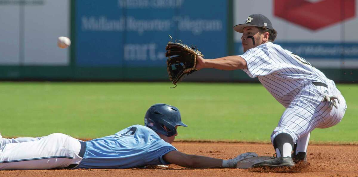 Greenwood's Chase Leatherwood beats the pick-off attempt at second as Big Spring's Jose Cantu reaches for the ball 03/13/21 at Momentum Bank Ballpark. Tim Fischer/Reporter-Telegram