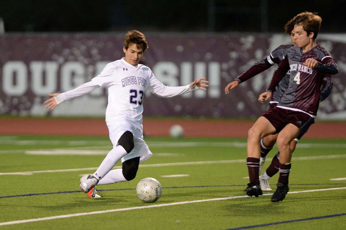 Luis Cunemo (23) of Ridge Point dribbles around Jack Taylor (4) of Cinco Ranch in 2019.