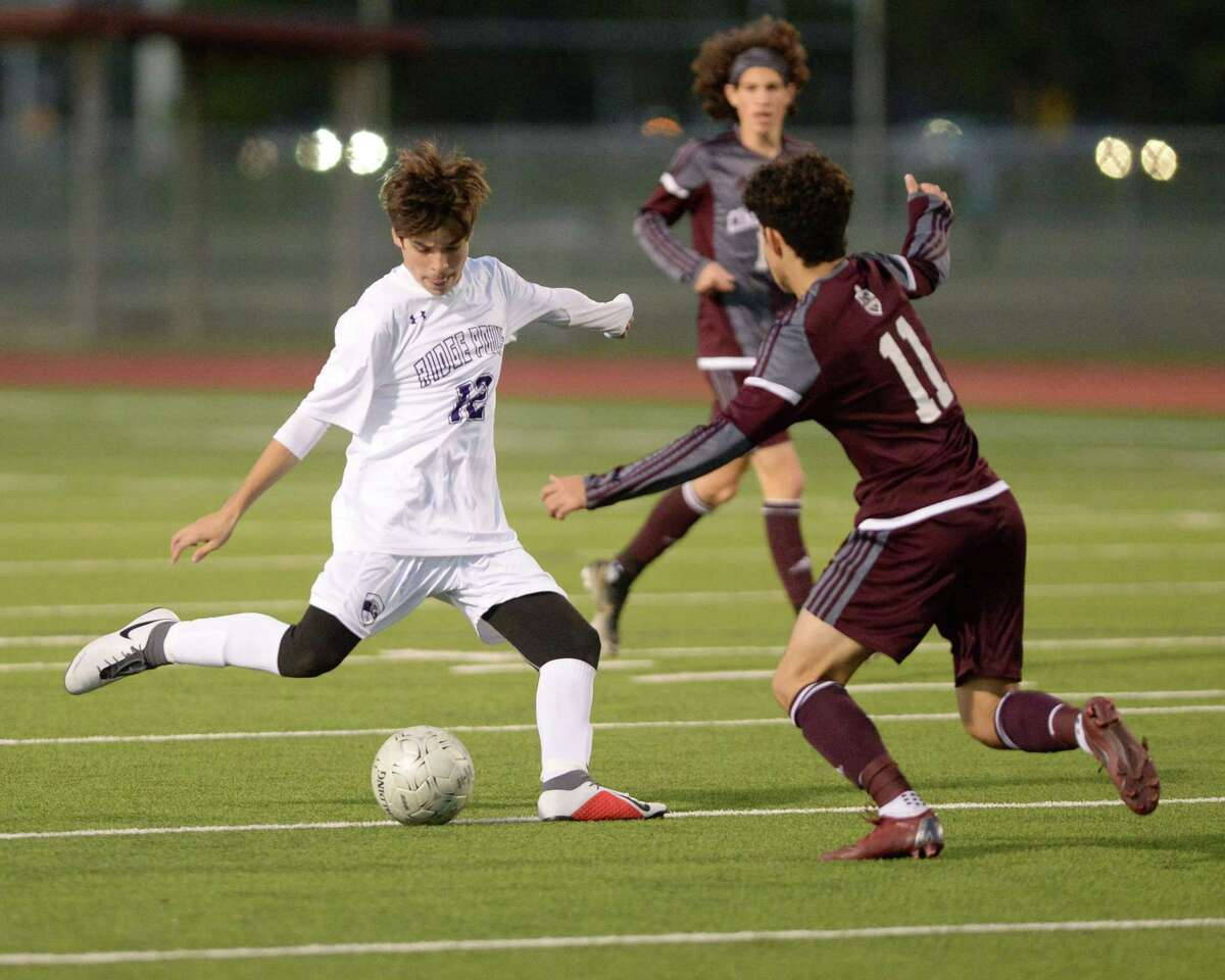 Alejandro Cunemo (12) of Ridge Point passes a ball during the first half of a high school soccer game between the Cinco Ranch Cougars and the Ridge Point Panthers on Saturday, January 5, 2019 at Cinco Ranch High School, Katy, TX.