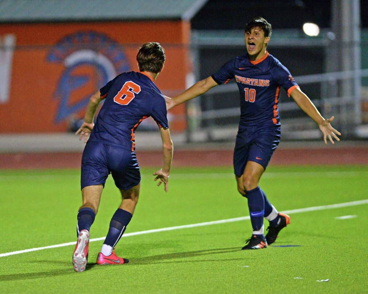 Vicente Garcia (10) of Seven Lakes reacts after a goal by Aidan Morrison (6) during the first half of a 6A-III District 19 soccer match between the Seven Lakes Spartans and the Cinco Ranch Cougars on Friday, March 12, 2021 at Seven Lakes HS, Katy, TX.